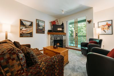 "Living Room - Bright and welcoming space adorned with Canadian art, 42"" TV with satellite, fireplace, Sony sound system, couch that pulls out into double bed."