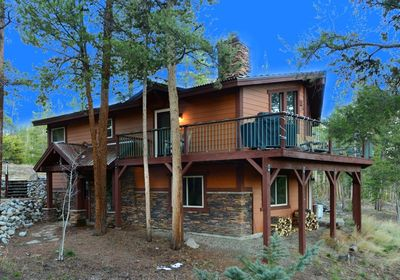 Home sits on two acres, with trees, views and plenty of room to play.