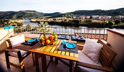 Photo for Attic with terrace on the river | Penthouse on the River