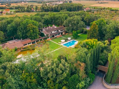 Photo for Tasteful villa with rose garden, swimming pool and golf training course