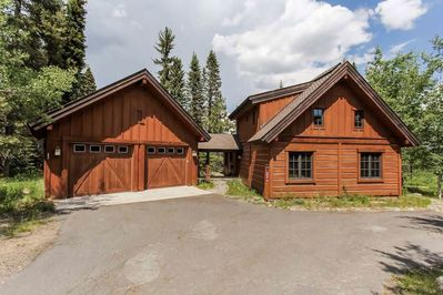 Front exterior of chalet with detached 2-car garage