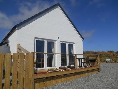 Photo for Detached cottage with patio and open sea views towards the Ascrib Islands