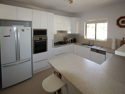 A modern fully equipped kitchen with Bosch cook-top,  oven and dishwasher.
