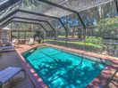 Screened pool and deck overlooking golf course at 3 Battery Road