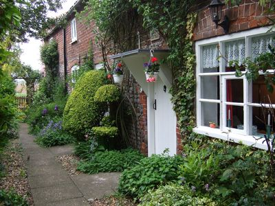 The Cottage front door and pathway, which is private for guests' use.