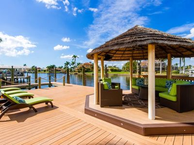 Photo for Casa Del Rio sailboat access to the Gulf of Mexico, unique rock waterfall heated pool, 3 bedrooms, 2
