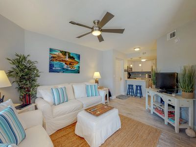 Photo for Pristine condo with shared pool, hot tub, and balcony with partial ocean view