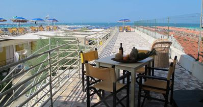 Photo for Apartment on the beach with private terrace