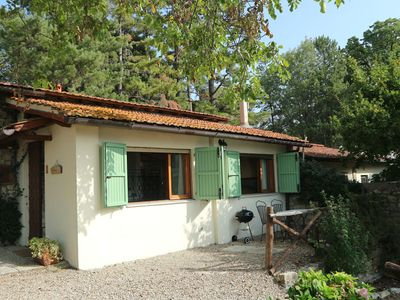 Photo for Authentic apartment in vineyard with swimming pool and views over wooded Tuscany