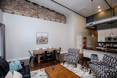 Dining area for the entire group with more beautiful exposed brick.