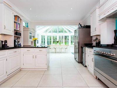 Photo for Classic, family home with a beautiful conservatory and charming garden (Veeve)