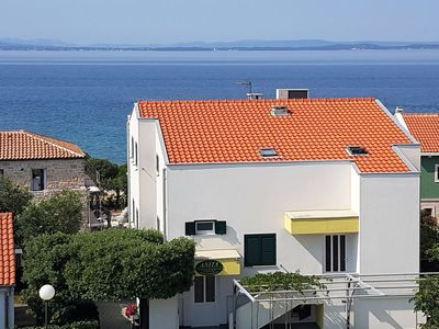 Photo for Comfortable apartment with coverd balcony and sea view, 50 meters from the beach
