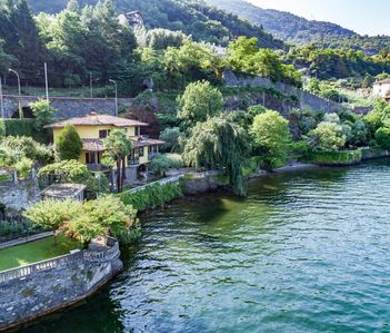 Photo for Villa Mina, by the lake with beach and botanical garden
