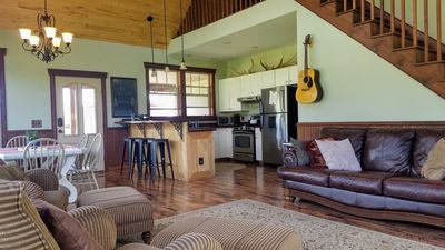 Open floor plan perfect for gathering.  House guitar in living room.