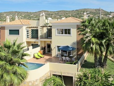 Photo for This 4-bedroom villa for up to 8 guests is located in Santa Barbara De Nexe and has a private swimmi