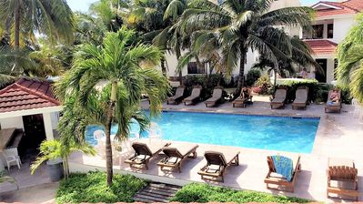 Photo for Tradewinds Paradise Villas - Upper Poolside with partial view of the ocean