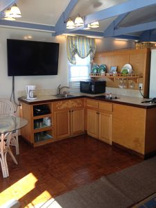 View of the kitchen area. Direct TV and internet access.