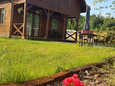 Photo for A comfortable wooden house for 6 people by the lake in Bory Tucholskie