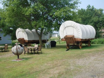 Photo for A one of a kind stay in a Conestoga Covered wagon on the shores of Rose Lake