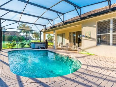 "Photo for ""Relax in Your Hot Tub while the Kids Play in the Pool""7826 - Four Bedroom Villa, Sleeps 9"
