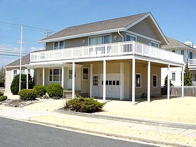 Photo for BEACH BLOCK of 66th Street. FEATURES a large wrap-around deck for your enjoyment