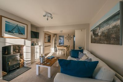 Lounge opens into dining area to give spacious feel. Comfy sofa & woodburner