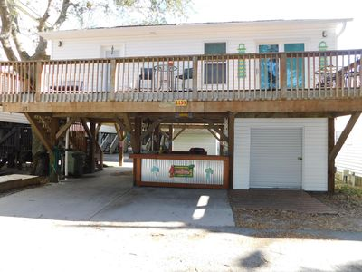 Photo for 3 bdrm on stilts with golf cart steps from the ocean