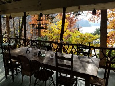 The 2nd farm table for 10, located on the porch. Dining and overlooking the lake