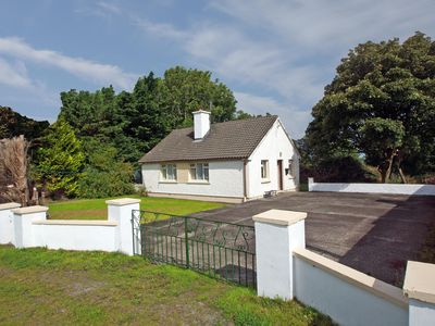 Photo for Detached cottage in grounds of 1⁄3 acre with parking, situated on the road from Tralee to Cast…