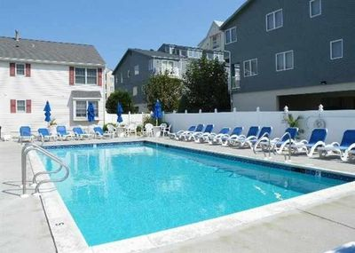 Beautiful, heated pool! Lots of tables and chairs and a shaded canopy area.