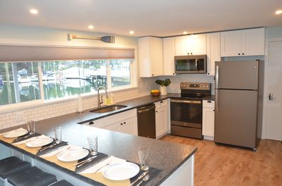 Newly remodeled kitchen with granite counters and beautiful views