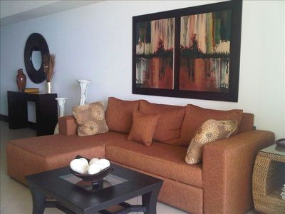 High end sectional, converts to a queen sized bed, very comfortable, no spring.