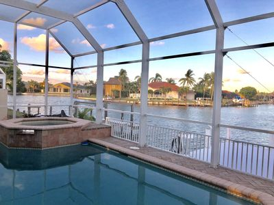 Photo for Gorgeous views from this very spacious waterfront Marco Island heated pool home