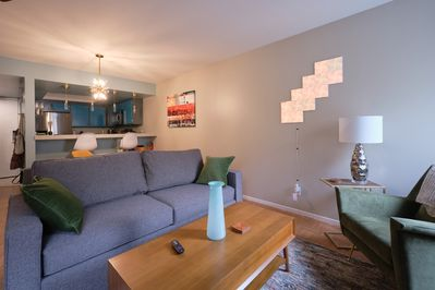 Living room has Smart TV, Queen Sleeper Sofa (sleeps 2), fireplace, games.