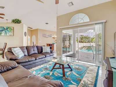 Photo for Bring the Family! SW Cape Coral Home - Heated Screened in Pool - Privacy Fence - Beach Gear - WiFi