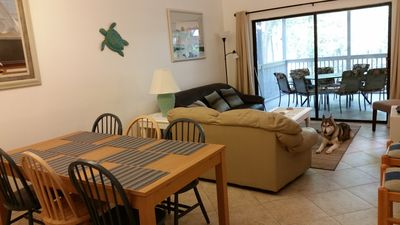 Photo for Dog-friendly 3-BR 3-BA, screened patio overlooks pool, near beach & Coligny!