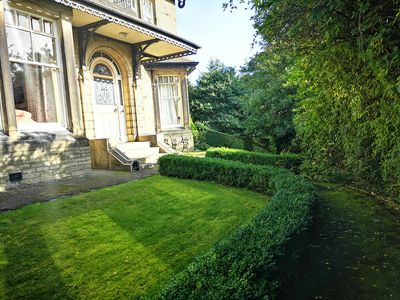 The front garden is south facing and a suntrap
