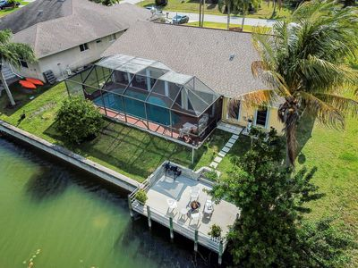 Photo for New Listing! Large gorgeous 3 bed 3 bath waterfront house with pool and dock.