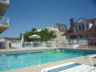 Photo for Beach and Boardwalk - End unit overlooking pool.