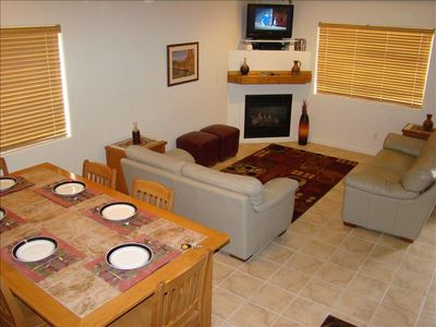Very comfortable living room!  Flat screen televison, and space for everyone!