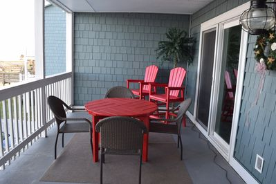 Tall chairs overlook railing for great ocean views! table for outside coffee!