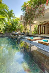 Sunlounges by pool.  Plenty of room whether you want sun or shade.