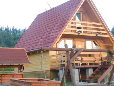 Photo for Cozy wooden cottages near the PILSKO ski station