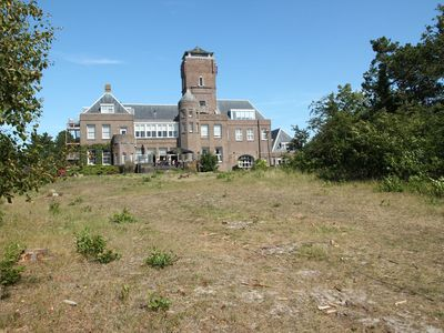 Photo for Cosy apartment on a large estate with balcony featuring a view of Bergen aan Zee