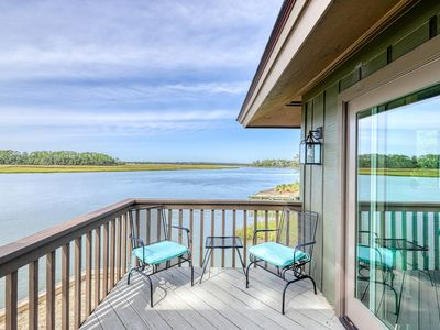 Photo for Updated, waterfront cottage w/ river views & a shared pool - near golf & more!