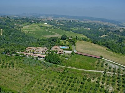 Photo for Lovely apartment with pool, WIFI, pets allowed, panoramic view and parking, close to San Gimignano
