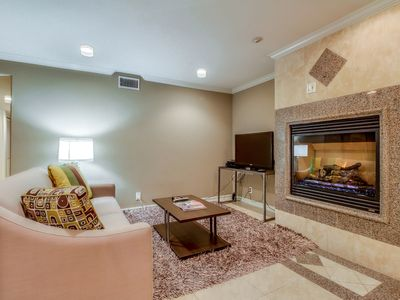 Photo for Gorgeous contemporary condo just steps from the beach! Includes relaxing patio!