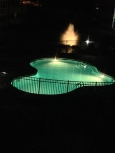 View of the pool at night from the pario