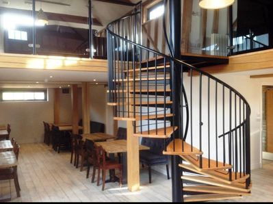 Inside the Main Barn, stairs leading to the Mezzanine Lounge