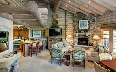 Living Room with Floor to ceiling stone wood burning fireplace(with gas starter)